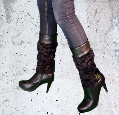 Woman wearing Llynda More black tapered heel boots with jeans.